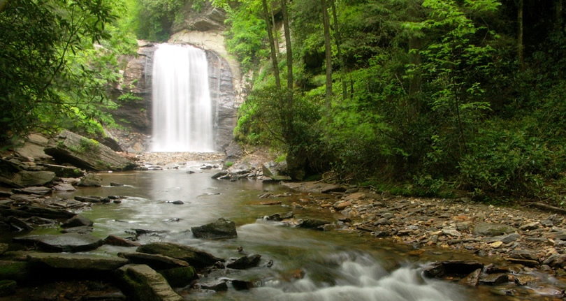 Looking Glass Falls as seen from the river downstream, beside US Hwy. 276, Pisgah National Forest, NC near Meadowbrook Log Cabin Photo by WNC Outdoors