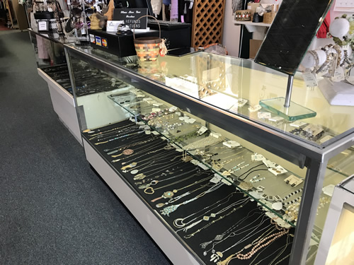 The Beehive has cases with new and consignment jewelry. - Beehive Resale Shop 449 N Main St, Hendersonville, NC