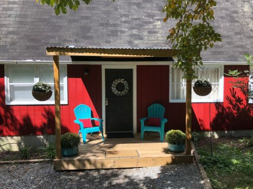 Plenty of privacy on the front porch at Apple Barn Cottage in Flat Rock, Hendersonville, NC