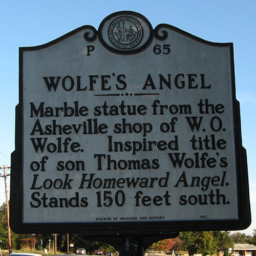 Wolfe's Angel Marble statue from the Asheville shop of W.O. Wolfe. Inspired title of son Thomas Wolfe's Look Homeward Angel. Stands 150 feet south. - Look Homeward Angel (Thomas Wolfe's Angel) - Look Homeward Angel at Oakdale Cemetery – Near Meadowbrook Log Cabin, Hendersonville, NC