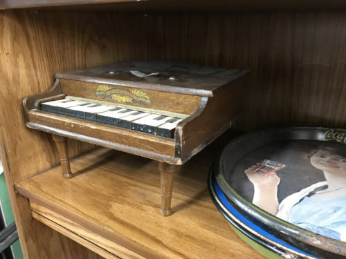 Little toy piano and some Coca Cola Memorabilia - Needful Things Antique Mall – Shopping near Meadowbrook Log Cabin, Hendersonville, NC