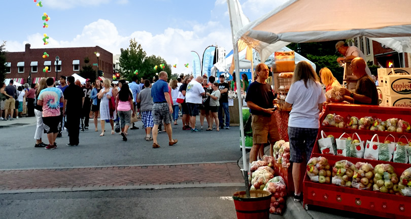 Venders set up all down Main Street selling fresh picked local apples and apple products, art, crafts and all kinds of things. - North Carolina Apple Festival - Things to do near Meadowbrook Log Cabin
