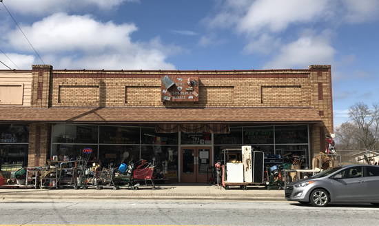 You know you're there when you see the sidewalk - Junk & Disorderly – Indoor Flea Market near Meadowbrook Log Cabin