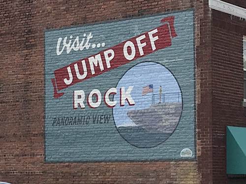Visit Jump Off Rock Mural on the wall at Brooks Tavern